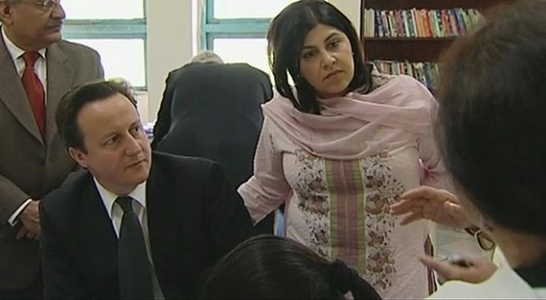 Baroness Sayeeda Warsi, Foreign Office Minister, with Prime Minister David Cameron of Britain. She resigned protesting the British government's silence on Israel's war on Gaza.